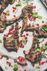 Lamb meat ribs barbecue with pomegranate seeds and herbs
