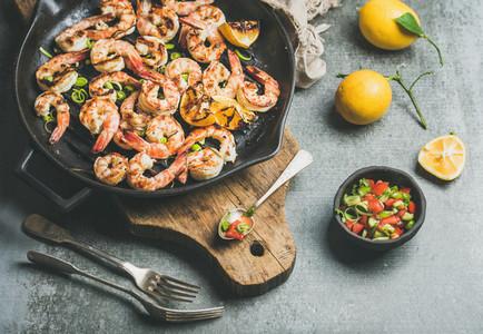 Grilled tiger prawns in pan with lemon  leek  chili  sauce