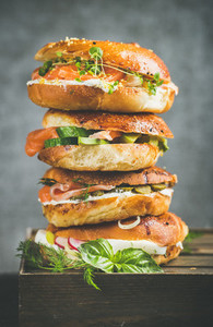 Heap of Bagels with salmon  eggs  vegetables  capers and cream cheese