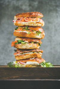 Close up of Bagels heap with salmon eggs vegetables and cream cheese