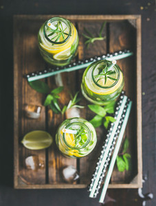 Citrus and herbs infused sassi water in wooden tray