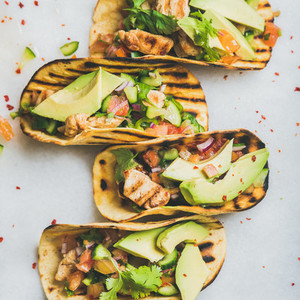 Healthy corn tortillas with grilled chicken fillet  avocado  fresh salsa