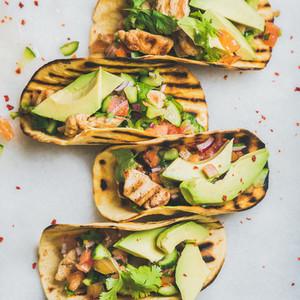 Healthy corn tortillas with grilled chicken fillet avocado fresh salsa