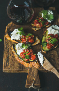 Bruschetta with grilled vegetables  cream cheese  arugula and red wine