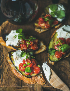 Brushetta with grilled eggplant  cherry tomatoes  garlic  cream cheese  arugula