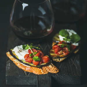 Wine  brushetta with eggplant  tomatoes  garlic  cream cheese and arugula