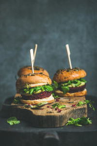 Healthy vegan burger with beetroot quinoa patty and arugula leaves