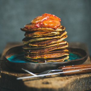 Homemade pancakes with honey and bloody orange slices square crop