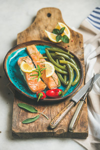 Roasted salmon fish with lemon rosemary chilli pepper poached beans