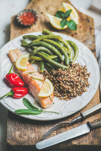Roasted salmon with quinoa  pepper and poached beans in plate