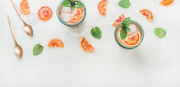 Homemade blood orange lemonade with mint and ice cubes