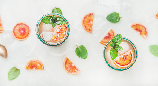 Homemade blood orange lemonade with mint leaves and ice cubes