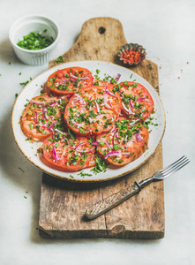 Fresh heirloom tomato parsley and onion salad Clean eating food