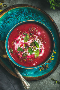 Beetroot soup with mint  chia  flax  pumpkin seeds  top view