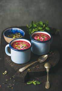 Detox beetroot soup with mint pistachio and seeds copy space