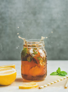 Summer Iced tea with lemon and herbs  copy space