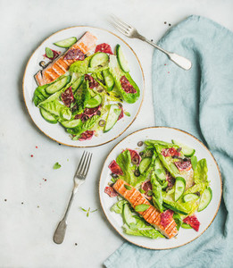 Healthy spring salad with grilled salmon  orange  olives and quinoa