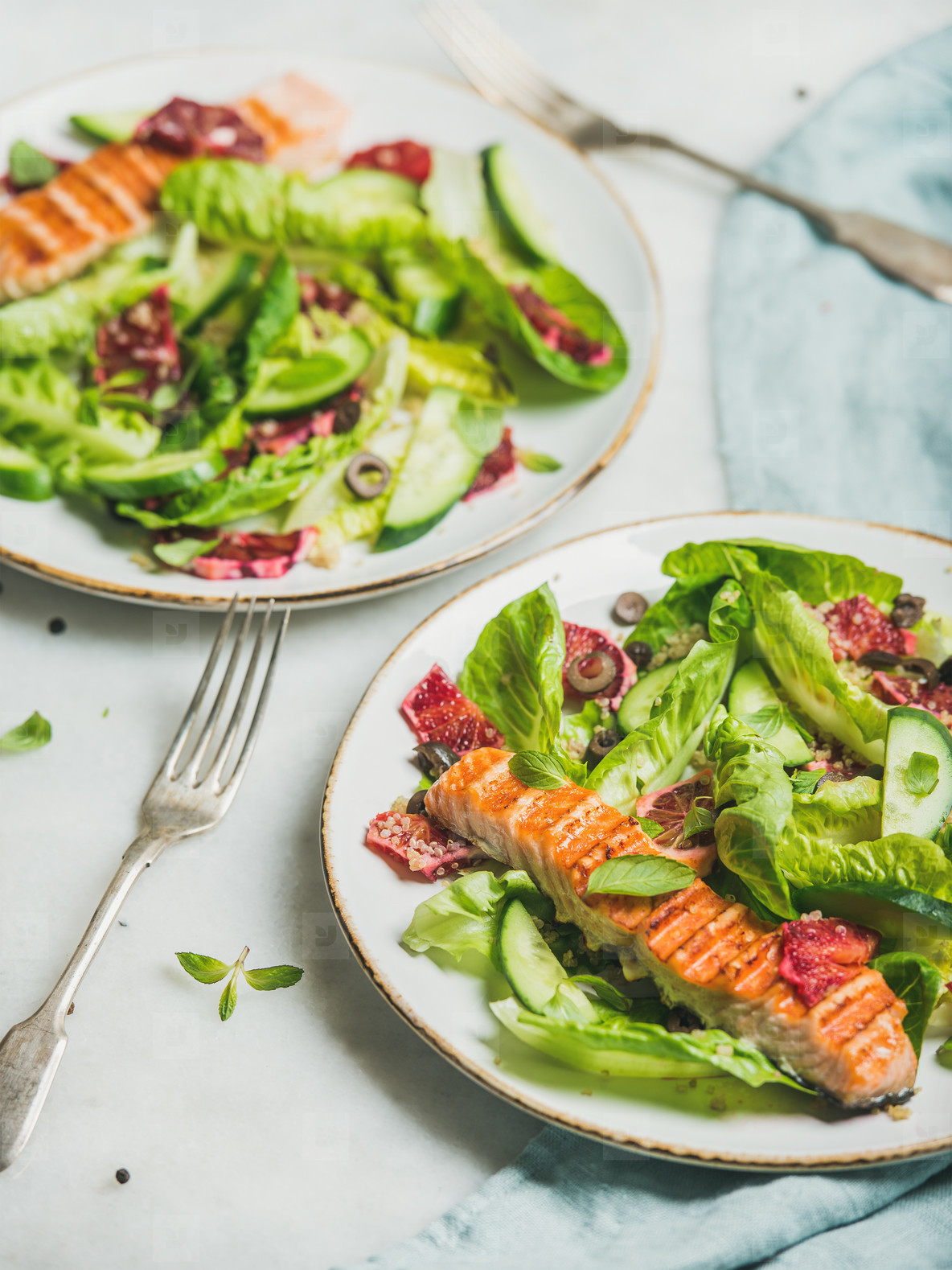 Healthy energy boosting spring salad with grilled salmon  orange  quinoa