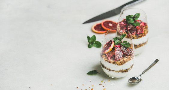 Healthy breakfast with greek yogurt granola blood orange layered parfait