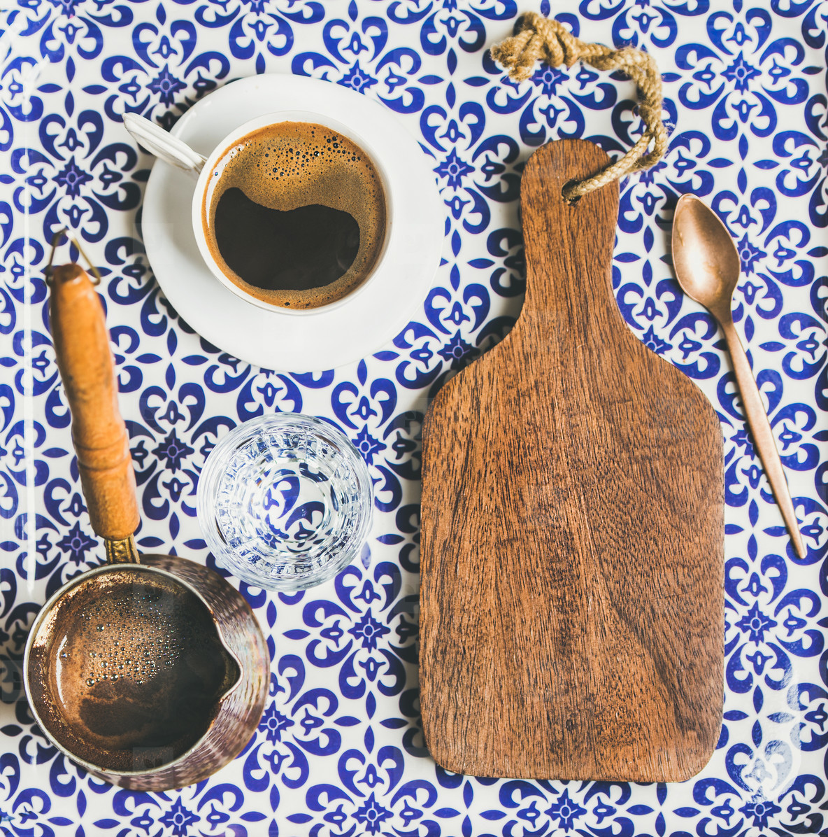 Black Turkish or Eastern style coffee in cup and cezve