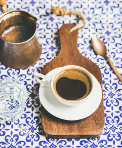 Black Turkish or Eastern style coffee on wooden board