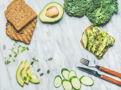 Avocado  cucumber  kale  kress sprouts  pumpkin seeds sandwich  copy space