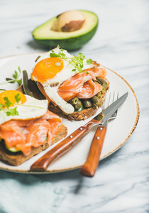 Salmon avocado fried egg sauted green beans and sprouts sandwiches