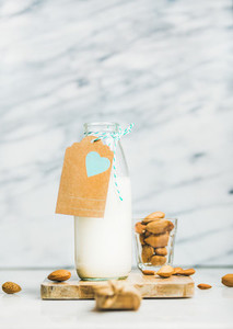 Fresh homemade dairy free almond milk with craft paper label