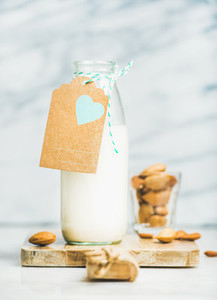 Fresh vegan dairy free almond milk in bottle with craft label