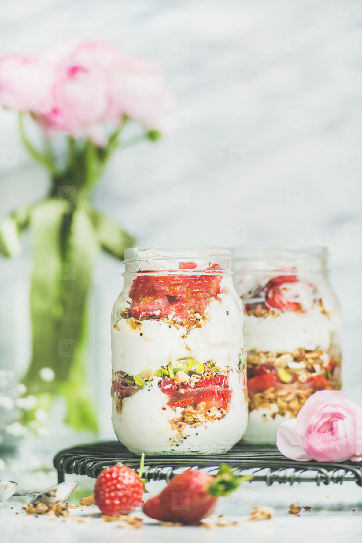 Greek yogurt  granola  strawberry breakfast jars  pink raninkulus flowers