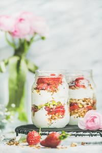Greek yogurt  granola  strawberry breakfast jars  pink raninkulus flowers