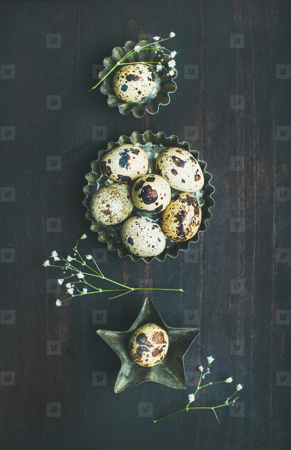Quail eggs in metal molds and dried flowers for Easter