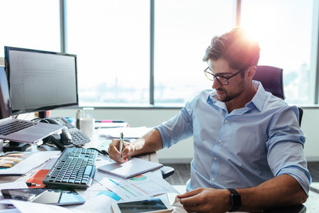 Businessman working at his desk in office