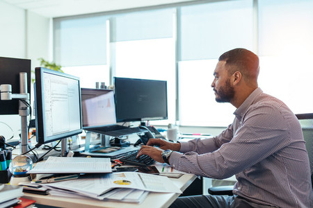 Businessman working on computer at his desk in office