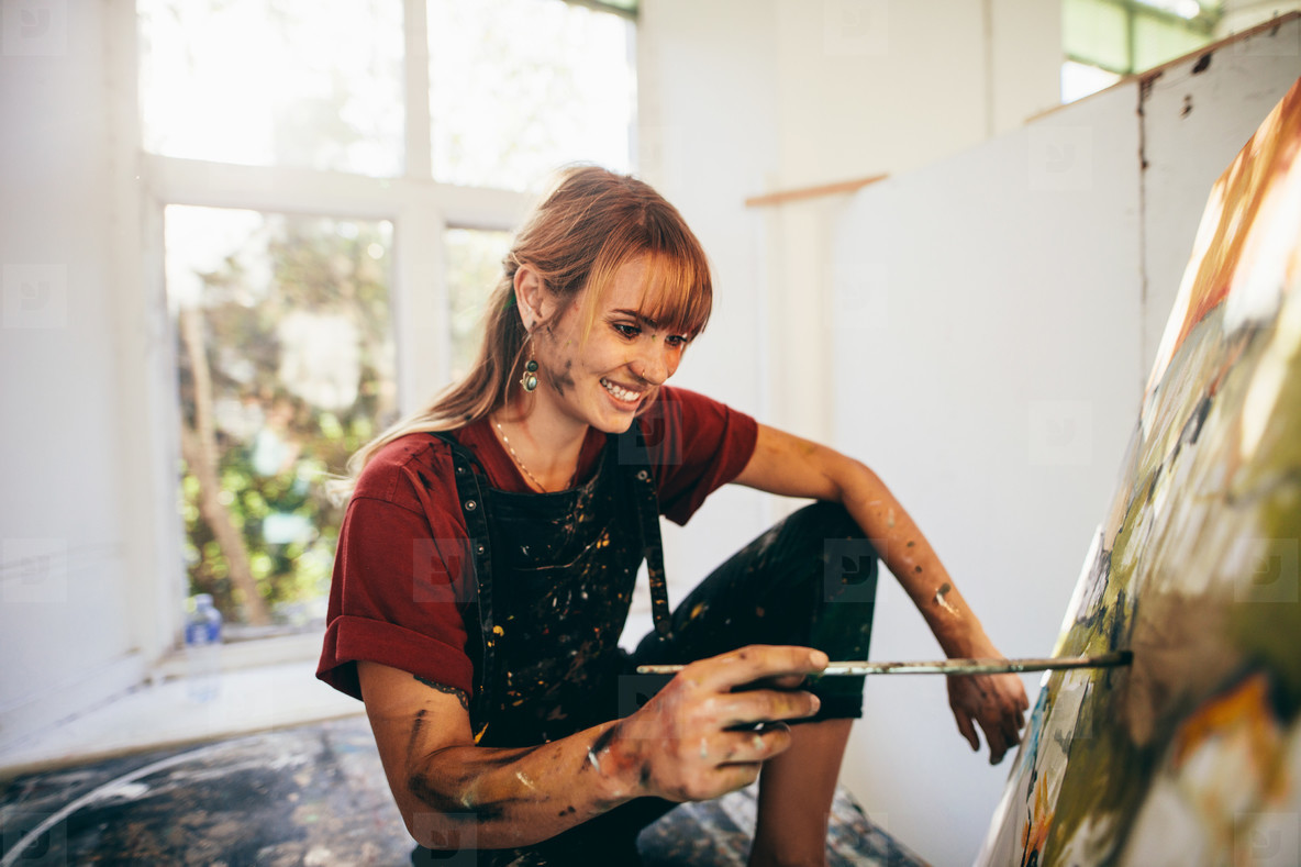 Professional painter working on canvas art
