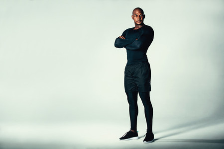 Fitness men in sportswear with his arms crossed