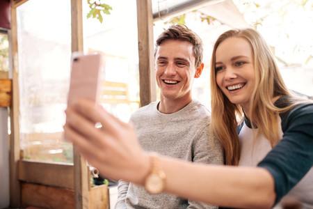 Happy couple making a selfie