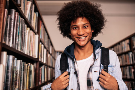 College student standing in library