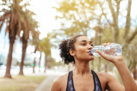 Athlete drinking water during morning jog
