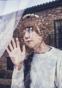 Young woman through a window