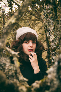 Brunette woman into the woods