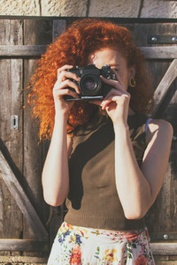 Young redhead photographer
