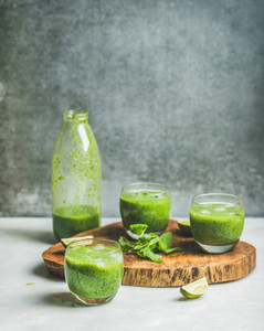 Healthy fresh smoothie in bottle and glasses  copy space