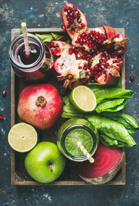 Green  purple fresh juices with fruits  greens  vegetables in tray