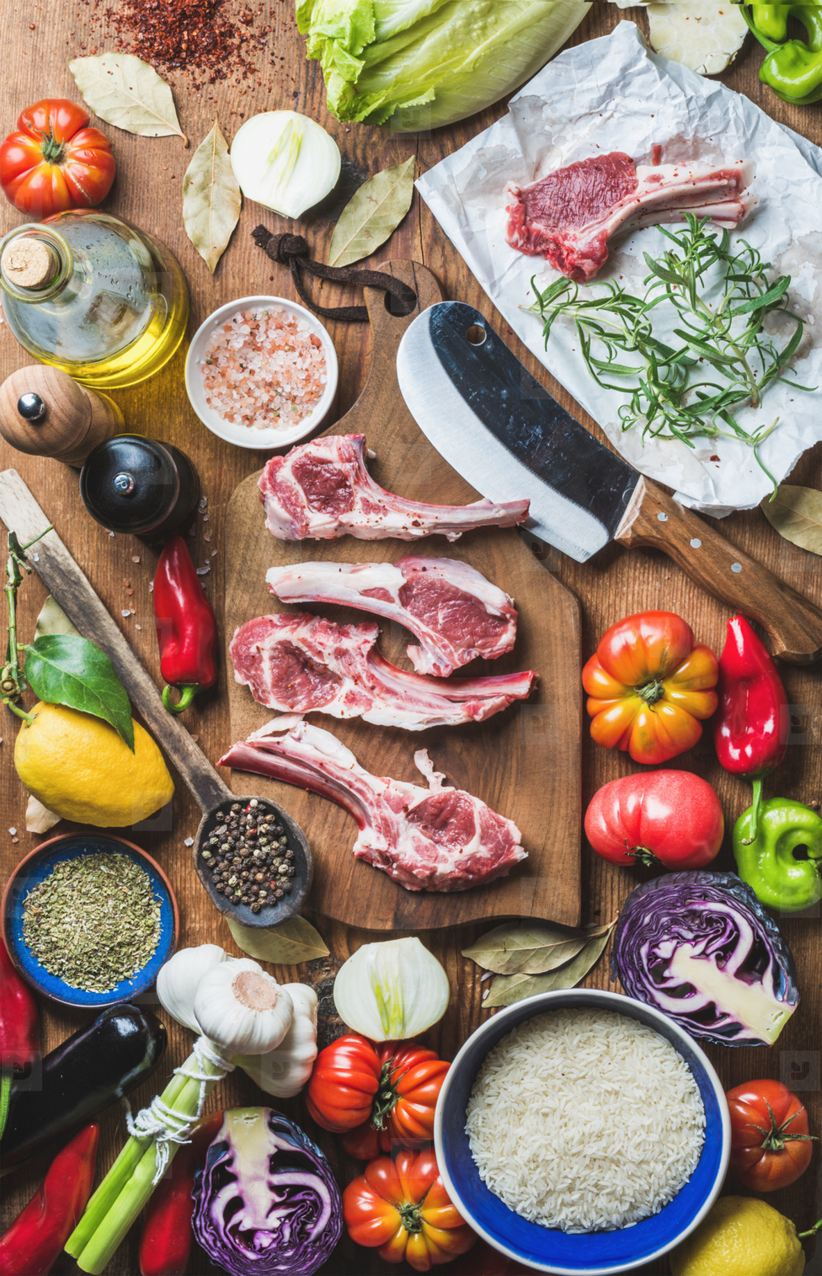 Raw uncooked lamb meat chops  rice  oil  spices and vegetables