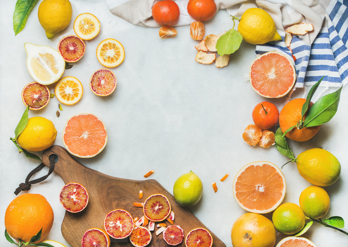 Natural fresh citrus fruits over grey marble table background