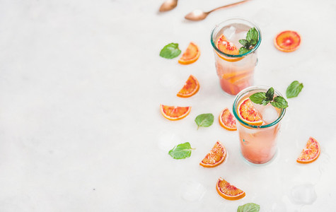 Blood orange fresh summer lemonade in glasses  copy space