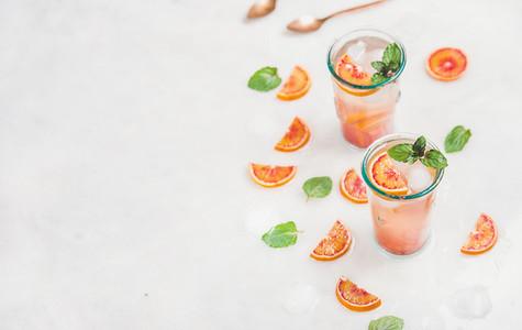 Blood orange fresh summer lemonade in glasses  copy space