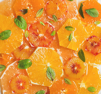 Fresh citrus fruit salad with mint and honey close up