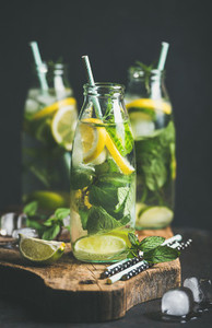 Citrus fruit and herbs infused sassi water in bottles
